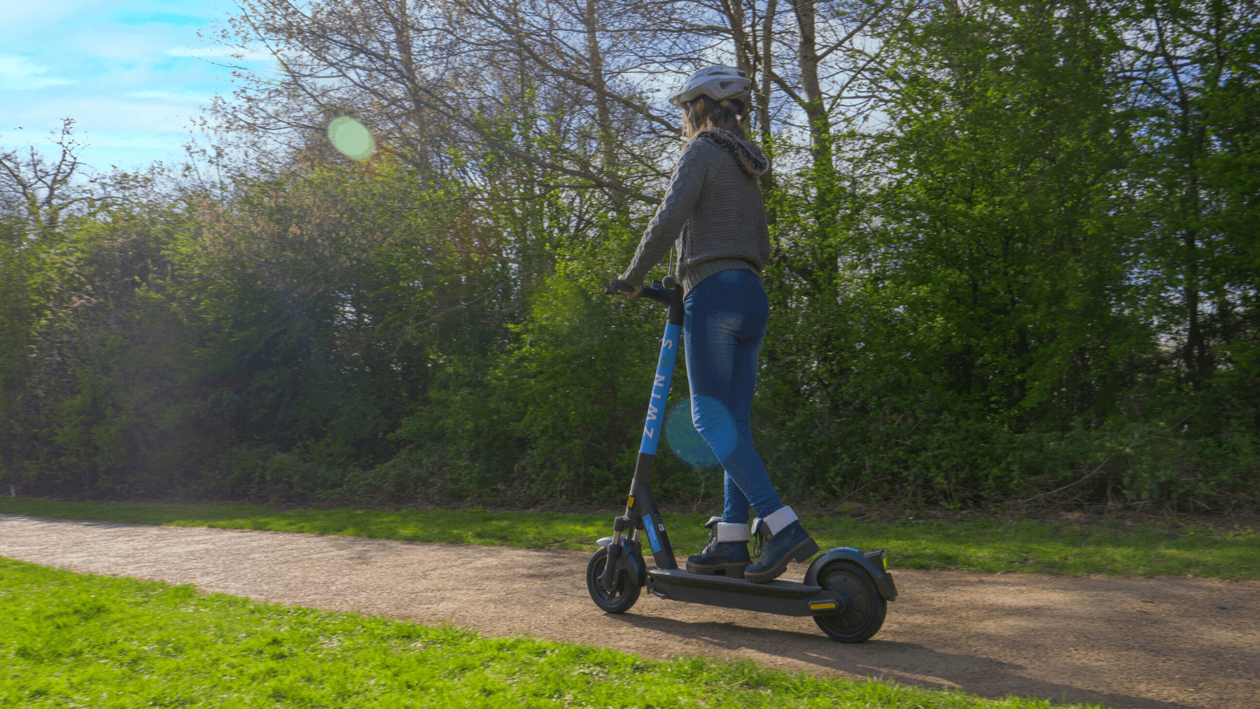 Girl riding on the Zwings e-scooter